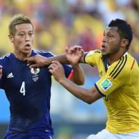 Start with a bang: Keisuke Honda (left) scored Japan's opening goal of the 2014 World Cup but could not live up to expectations thereafter. | AFP-JIJI