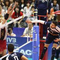 Playing the angles: France's Kevin Tillie earns a point against Japan during Sunday's FIVB World League Pool D match in Kyoto. France defeated Japan in four sets, improving to 9-1 on the season. FIVB