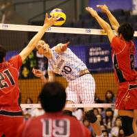 Attack mode: Argentina's Jose Luis Gonzalez finds a hole in Japan's defense during Saturday's match. FIVB