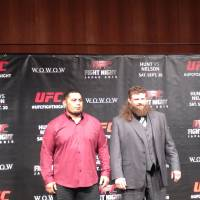 Promotion time: UFC heavyweights Mark Hunt (left) and Roy Nelson attend a news conference on Thursday in Tokyo. They'll square off on Sept. 20 at Saitama Super Arena. JASON COSKREY | OTHER (TEXT INPUT)