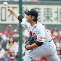 Solid work: Giants starter Tomoyuki Sugano fires a pitch against the Eagles on Saturday in Sendai. Sugano worked 7-1/3 scoreless innings in Yomiuri's 3-1 victory over Tohoku Rakuten. | KYODO