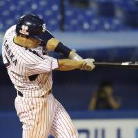 Blow it open: The Swallows' Hiroyasu Tanaka hits a two-run triple against the Chiba Lotte Marines on Wednesday at Jingu Stadium. The Swallows won 14-3. | KYODO