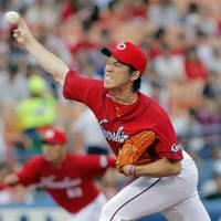 The right stuff: Carp ace Kenta Maeda holds the BayStars scoreless in a seven-inning outing on Friday at Yokohama Stadium. Hiroshima defeated Yokohama 6-0.   | KYODO
