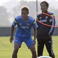 Preparation: Japan's Keisuke Honda, warming up in Itu, Brazil, on Sunday, says his team needs faces a big challenge against Greece in a World Cup Group C match on Thursday. AP