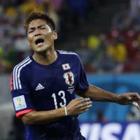 Onward and upward: Forward Yoshito Okubo insists the mood in Japan's camp is not gloomy ahead of Thursday's game against Greece despite losing their World Cup opener to Cote d'Ivoire. | AP