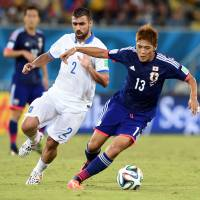 Japan players say man advantage hurt more than it helped against Greece