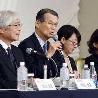 Teruo Kishi (second from left), head of an outside panel set up to review the embattled Riken research institute, addresses the media at Thursday evening in Tokyo about its proposals for preventing research misconduct after an incident involving stem cell researcher Haruko Obokata. | KYODO