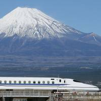 A bullet train runs past Mount Fuji on the Tokaido Shinkansen Line last November. | KYODO