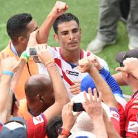 Exuberant Costa Rica turns heads at World Cup