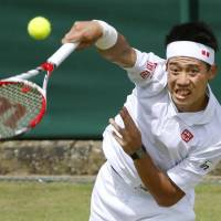 No job for the timid: Kei Nishikori hits the ball in a second-round Wimbledon match against Denis Kudla on Thursday. Nishikori defeated his foe 6-3, 6-2, 6-1. | KYODO