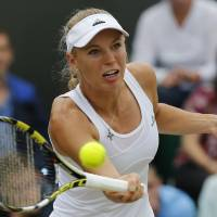 Hustle: Caroline Wozniacki plays a return to Ana Konjuh during their women's singles third-round match at Wimbledon on Friday. AP | AP