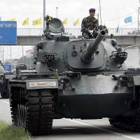 Thai junta keeps tanks in barracks as protests dwindle