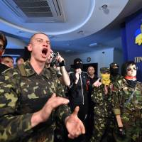Ukrainian forces reclaim port city from rebels