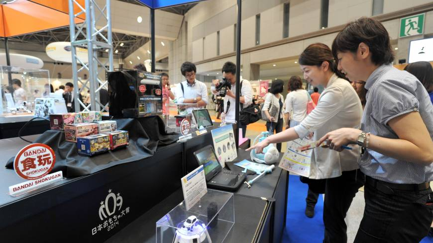 Christmas in June: Visitors check out the thousands of new toys, gadgets and games at the International Tokyo Toy Show on Thursday.