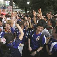 Blue wave: Expect to see an abundance of blue soccer shirts during the FIFA World Cup, which lasts from June 12 until July 13. The large time difference between host country Brazil and Japan means you'll probably see a lot of red eyes as well. | REUTERS