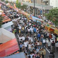 Festival fun: Visitors enjoy the numerous stalls at the Enma-ichi festival.