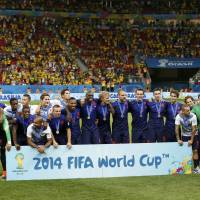 Netherlands players pose with their medals after defeating Brazil in the third-place playoff on Saturday at the Brasilia national stadium in Brasilia  | REUTERS
