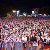 Fans watch Sunday's final between Germany and Argentina at a public screening in Berlin.    REUTERS
