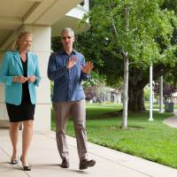 Apple CEO Tim Cook and IBM CEO Ginni Rometty take a stroll at Apple's headquarters in Cupertino, California. | COURTESY OF IBM