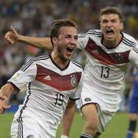 Germany midfielder Mario Goetze (left) celebrates with teammate Thomas Mueller after scoring in the 113th minute of Sunday's final against Argentina.    AFP-JIJI