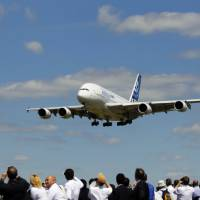 An Airbus A380, produced by Airbus Group NV, prepares to land after performing in an aerial flying display on the first day of the Farnborough International Airshow in Farnborough, southern England, on July 14. | BLOOMBERG
