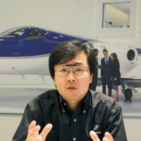 Mi­chi­ma­sa Fu­ji­no, president and CEO of Honda Aircraft, speaks during a recent interview in Oshkosh, Wisconsin. | KYODO