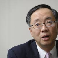 Haruo Inoue, president of Mitsubishi UFJ Nicos Co., is betting that Japan will increasingly ditch cash for electronic money toward the Olympics. | BLOOMBERG