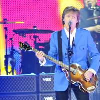 Get back: Singer Paul McCartney takes the stage in Albany, New York on July 5. The musician canceled his Japan tour earlier this year because of a virus. | AP