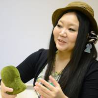 Photo taken in May shows blues singer Marikofun, who sings about ancient tomb mounds, called 'kofun' in Japanese. In the previous month, the musician, whose real name and age remain undisclosed, released her first album titled 'Kofun de Kofun!' using two senses of 'kofun,' which means both 'ancient tomb mound' and 'excited.' | KYODO