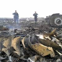 Emergencies Ministry members work at the site of a Malaysia Airlines Boeing 777 plane crash in the settlement of Grabovo in the Donetsk region of Ukraine on Thursday. The airliner was allegedly shot down by pro-Russian militants, killing all 295 people aboard.   REUTERS