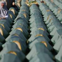 Bosnia buries 284 war victims unearthed from gruesome death pit