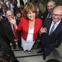 The new leader of the Irish Labour Party, Joan Burton, arrives at the Mansion House in Dublin following the ballot count for the leadership elections on Friday. | AP