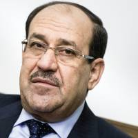Al-Maliki signals intent to remain