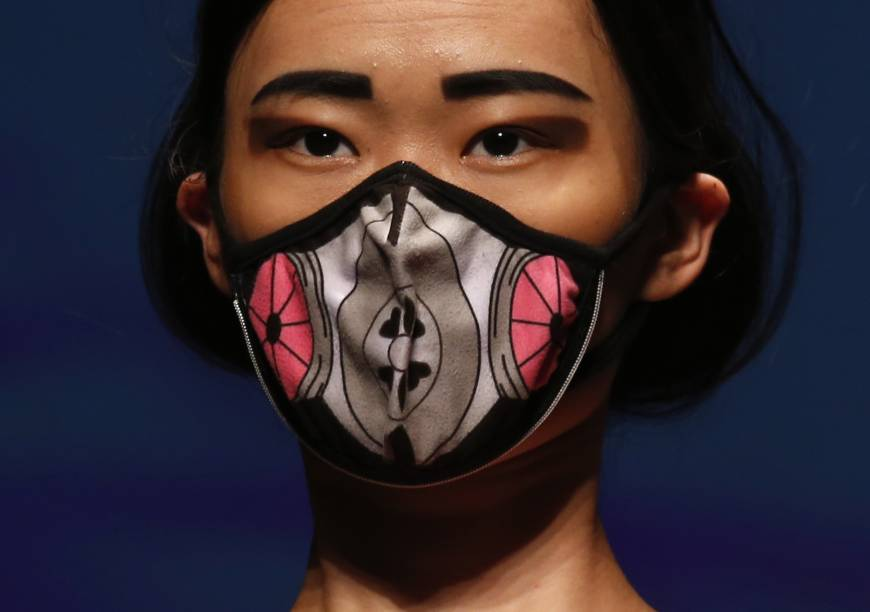 Model wears a vogmask brand face mask with air filters that provide