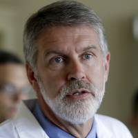 Dr. David Mcray speaks about his friend and colleague Dr. Kent Brantly during a news conference Monday in Fort Worth, Texas. | AP