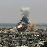 Rockets hit Israeli heartland amid biggest Gaza offensive in two years