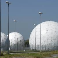 Radomes stand on the former monitoring base of the U.S. National Security Agency in Bad Aibling, near Rosenheim, southern Germany. German ministers on July 6 called for a swift response from the U.S. to allegations of spying by a suspected double-agent, which have raised fears of fresh tensions between the two allies. | AFP-JIJI