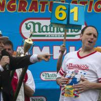 Chestnut keeps hot dog title, wins fiancee
