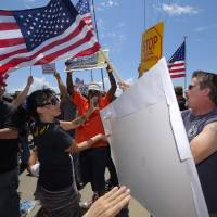 Americans clash over immigration on Independence Day