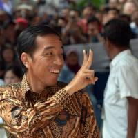Indonesian presidential candidate Joko Widodo smiles after voting in Jakarta on Wednesday. | AFP-JIJI