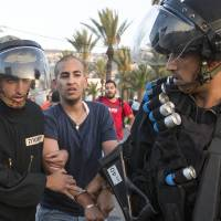 Israeli police detain dozens of protesters as riots over teen murder spread