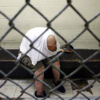 U.S. jails struggle as stopgap asylums