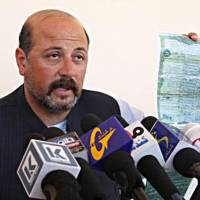 The cousin of outgoing Afghan President Hamid Karzai, Hashmat Karzai, speaks during a press conference in Kandahar on Feb. 21, 2013. He was killed by a suicide attacker near the volatile southern city of Kandahar, officials said, raising tensions during a struggle over the contested election result. | AFP-JIJI