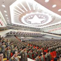 Delegates to the April 25 House of Culture, a theater in Pyongyang, salute during a meeting on Saturday. North Korea the same day conducted its first missile launch since the U.N. Security Council on July 17 officially condemned the country for its recent series of ballistic missile tests. | AFP