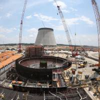 Construction continues on a new nuclear reactor at the Plant Vogtle power plant in Waynesboro, Georgia, on June 13. Atomic power's share of the global electricity supply is at the lowest level since the 1980s following the shutdown of Japan's reactors after the Fukushima disaster, and may fall further without major new plant construction, a new report says. | AP
