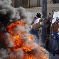 Clashes erupt in West Bank as Palestinians accuse Israeli extremists of murdering teen