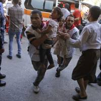 15 die as U.N. school in Gaza gets caught in cross-fire