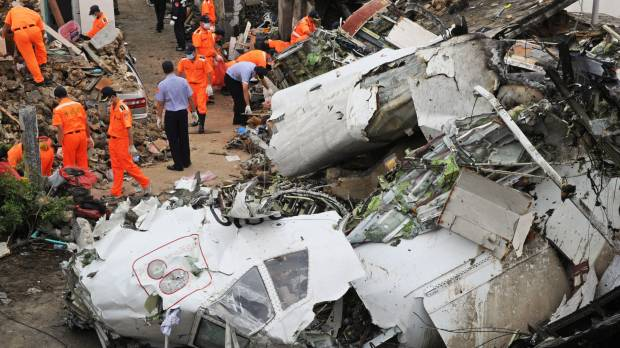 Taiwan says weather not seen as cause of plane crash that killed 48