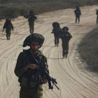 Israeli troops, using sniffer dogs and robots, hunt for Gaza tunnels