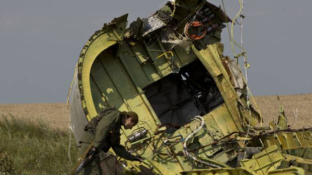 Flight MH17 wreckage riddled with telltale signs of missile strike